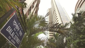 Sensex climbs the most in a month; rupee rises to 64.44