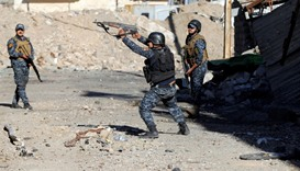 Members of the Iraqi Federal Police clash with the Islamic State fighters in western Mosul
