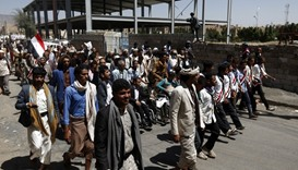 """Yemeni men take part in a """"protest for bread"""" march from the capital Sanaa to the coastal town of Ho"""