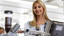 Ivanka Trump, daughter and adviser of US President Donald Trump looks at a device when visiting the
