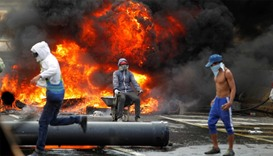Demonstrators build a fire barricade on a street during a rally against Venezuela's President Nicola