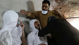 FILE PHOTO: A man breathes through an oxygen mask as another one receives treatments, after what res
