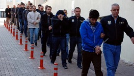 Suspected supporters of the US-based cleric Gulen are escorted by plainclothes police officers