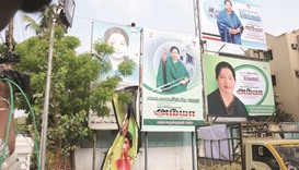 A worker removes the banners of V K Sasikala from the AIADMK headquarters in Chennai yesterday.