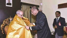 President Pranab Mukherjee being felicitated by Telangana Governor E S L Narasimhan in Hyderabad yes