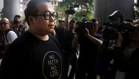 Scholarism activist Derek Lam (L) arriving at court in Hong Kong