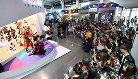 people crowded around a display as they visit the China International Cartoon and Animation Festival