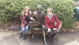 The author's sister, Jennifer Stillman, and mom, Juliet Roberts, pose beside a sculpture of Thomas J