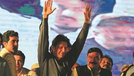 Imran Khan, chairman of the Pakistan Tehreek-e-Insaf (PTI), waves to supporters during an anti-gover