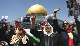 Families of Palestinians imprisoned in Israeli jails demonstrate outside the Dome of the Rock at the