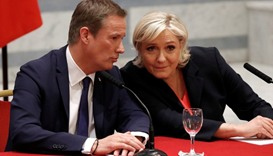 Marine Le Pen and Nicolas Dupont-Aignan (L) attend a news conference in Paris, France