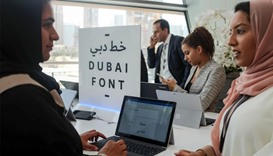 "Attendees look at computers showing the ""Dubai Font"", the first typeface developed by Microsoft for"