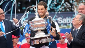 Rafael Nadal raises up the trophy.