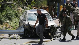 Israeli security forces gather at the site of a car ramming attack