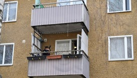 A police photographer takes pictures during a house search in an apartment in Varberg south west of