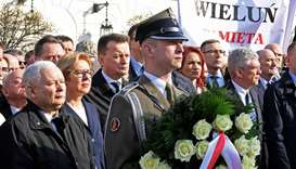 Jaroslaw Kaczynski (L) attends a ceremony marking the eighth anniversary of the presidential plane c