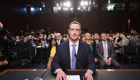 Facebook CEO Mark Zuckerberg arrives to testify before a joint hearing of the US Senate Commerce, Sc