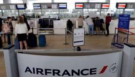 Passengers arrive at the Air France check-in at Bordeaux-Merignac airport, as Air France pilots, cab
