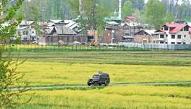 Indian army vehicle patrols near the site of a gun battle at Khudwani area of Kulgam
