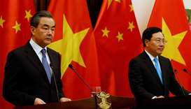 China's State Councilor and FM Wang and Vietnam's DPM and FM Minh attend a news conference in Hanoi