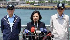 Taiwan President Tsai Ing-wen (C) speaks as David Lee, Chief of Taiwan's National Security Council (