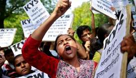 A woman reacts at a protest against the rape of an eight-year-old girl, in Kathua, near Jammu and a