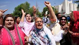 Supporters of Nawaz Sharif chant slogans following the Supreme Court decision to disqualify Sharif f