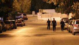 Pedestrians walking in an empty street before the daybreak Muslim prayer in Damascus' Mazze neighbou
