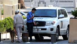UN vehicles carrying the Organisation for the Prohibition of Chemical Weapons inspectors arrive in D