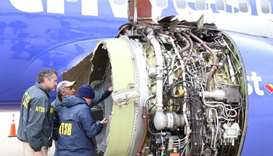 US NTSB investigators are on scene examining damage to the engine of the Southwest Airlines plane