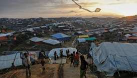 Rohingya refugee children fly improvised kites at the Kutupalong refugee camp near Cox's Bazar, Bang