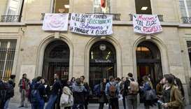 Students block the entrance of Sciences Po university as part of nation-wide demonstrations against