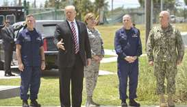 US President Donald Trump speaks to reporters during a visit to Joint Interagency Task Force South a