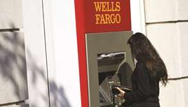 US fines Wells Fargo $1bn for mortgage, auto loan violations