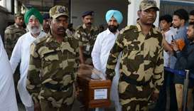 Indian Central Industrial Security Force (CISF) personnel carry the coffin of Nand Lal, who was kill