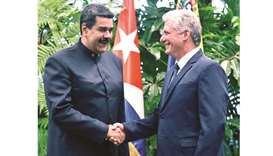 Venezuelan leader pays visit to new Cuban president