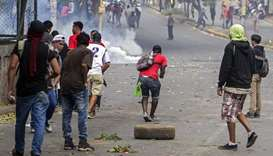 Students clash with riot police agents close to Nicaragua's Technical College during a protest again