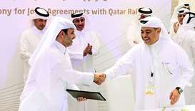 Qatar Rail CEO Abdulaziz Turki al-Subaie and QNB Group CEO Ali al-Kuwari (right) at the signing