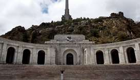 A woman takes pictures at the Valle de los Caidos (Valley of the Fallen) mausoleum outside Madrid