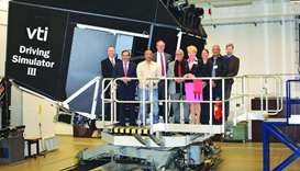 The delegation at the VTI driving simulator.