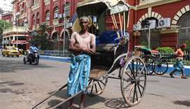 Rickshaw pullers slowly fade from India's streets