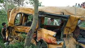 13 children die after train hits school bus in India