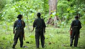 Indian Maoists patrol their village in Bijapur district in Chhattisgarh. July 6, 2012 file photo.