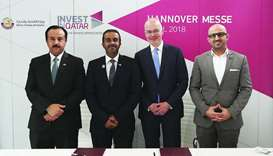 Officials of the MEC and the Dutch company HERE Global at the signing ceremony in Hanover, Germany.
