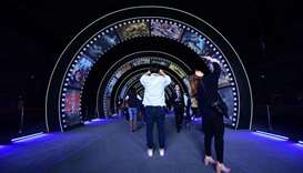 People visit a film studio at Wanda Film industrial park in Qingdao, China's Shandong province