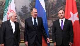 Russian Foreign Minister Sergei Lavrov (C), his Turkish counterpart Mevlut Cavusoglu (R) and Iran's