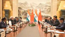 Chinese President Xi Jinping and Indian Prime Minister Narendra Modi attend a meeting at East Lake G