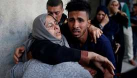 The mother of Palestinian who was killed along Israel border with Gaza, reacts at a hospital in the