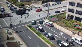 Officials are seen following a possible shooting at the headquarters of YouTube, in San Bruno