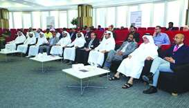 Qatar University and Ashghal officials at the workshop